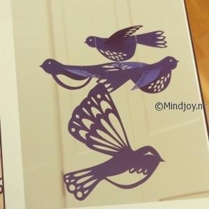 Papierknipkunst vliegende vogels